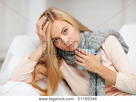 health and illness concept - indoor picture of diseased woman with cup of tea