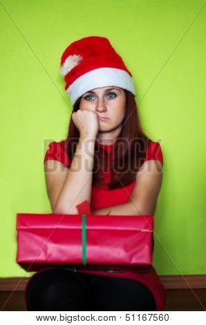 Bored And Disappointed Woman Holding Present