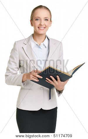 Portrait of young businesswoman or teacher with open notepad looking at camera in isolation