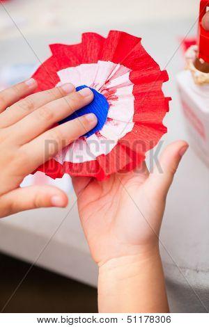 Close up of paper flower making for Bastille day celebration
