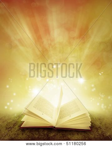 Open book and magical background