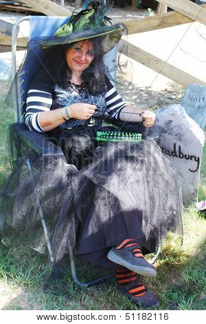 MUSKOGEE, OK - Sept. 14: Witches hide in the shade of the cemetery trees during the Castle Zombie Run at the Castle of Muskogee in Muskogee, OK on September 14, 2013.