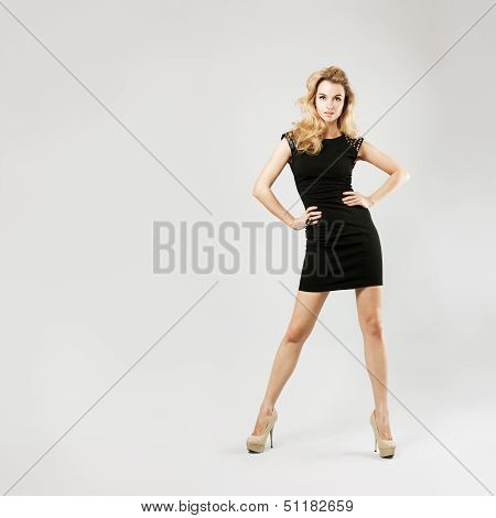 Beautiful Woman in Black Dress on Gray Backgound
