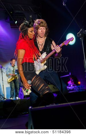 MOSCOW - SEPTEMBER 7: The Brand New Heavies group performs at Usadba Jazz Festival in Kuskovo Mansion on September 7, 2013 in Moscow. This festival was held on the Day of Moscow and was free to visit