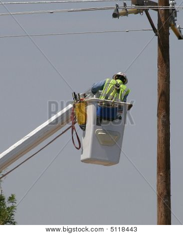 Electrical Worker In Bucket