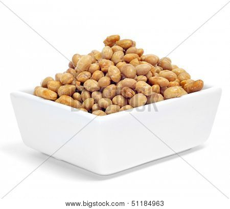 a bowl with roasted soya beans on a white background