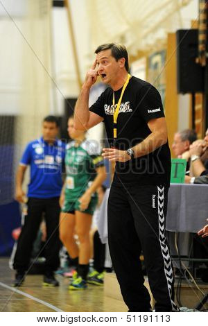 SIOFOK, HUNGARY - SEPTEMBER 14: Vlagyimir Golovin (Siofok trainer) in action at a Hungarian Championship handball match Siofok KC (black) vs. Gyor (green), September 14, 2013 in Siofok, Hungary.