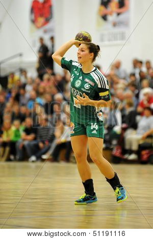 SIOFOK, HUNGARY - SEPTEMBER 14: Aniko Kovacsics in action at a Hungarian National Championship handball match Siofok KC (black) vs. Gyori Audi ETO KC (green), September 14, 2013 in Siofok, Hungary.