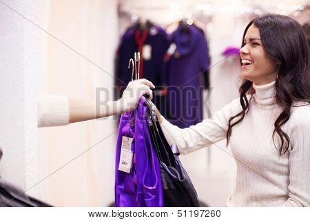 woman in dress room wear dress