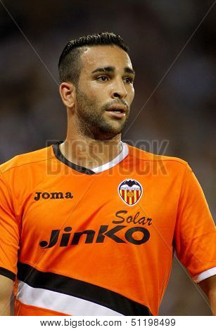 BARCELONA - AUG, 24: Adil Rami of Valencia CF in action during a Spanish League match against RCD Espanyol at the Estadi Cornella on August 24, 2013 in Barcelona, Spain