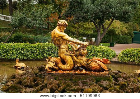 Fountain With A Statue Of Triton