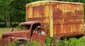 stock photo of sag  - Unique Rusting Vintage Truck with sagging door and weathered look - JPG