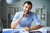 pic of beard  - Smart businessman looking at camera with smile in office - JPG