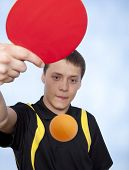 picture of ping pong  - Young man playing ping pong against a blue background - JPG