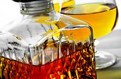 pic of liquor bottle  - closeup of a vintage glass liquor bottle and some cognac glasses with liquor - JPG