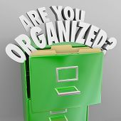 Постер, плакат: The words Are You Organized and question mark coming out of a green metal filing cabinet to illustra