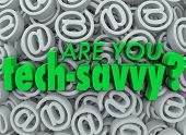 The words Are You Tech Savvy on a background of email at symbols or signs