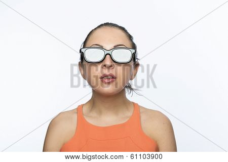 Portrait of beautiful caucasian woman wearing large 3D cinema glasses looking enthralled