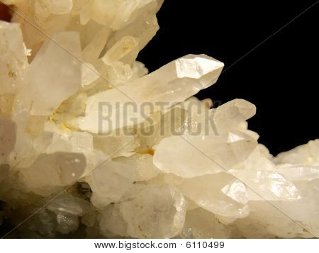 white crystals isolated on black background