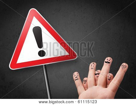 Happy cheerful smiley fingers looking at triangle warning sign with exclamation mark