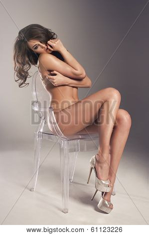 Sensual Brunette Woman With Long Curly Hair Sitting On Chair, Posing In Sexy Underwear