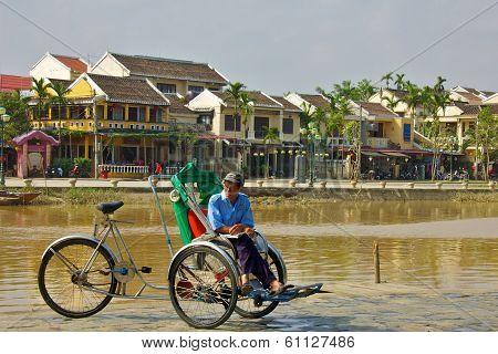 Hoi An, Vietnam - November 2013: Driver Waiting for Customer in Hoi An