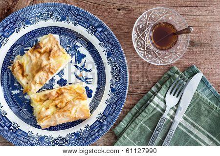 Slices Of Fresh Turkish Borek Served With Tea