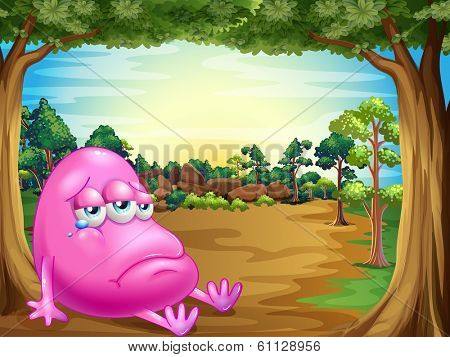 Illustration of a forest with a sad fat beanie monster
