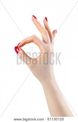 Woman hand ok sign. Isolated on white.