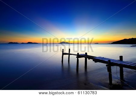 Sunset seascape with wooden pier