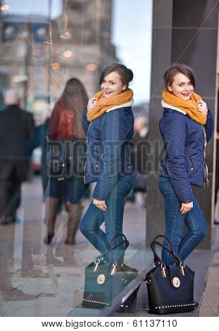 Pretty Young Girl Standing At Shopfront