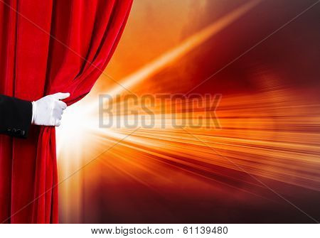 Human hand in white glove opening red velvet curtain