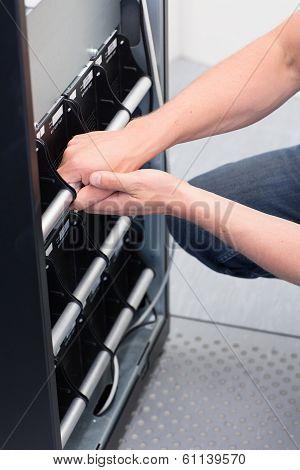 Technician Replace Battery Units on UPS