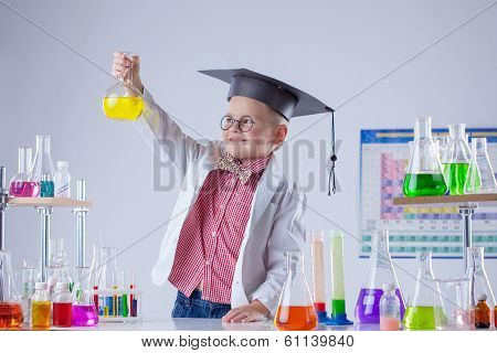 Little chemist posing with variety of reactants