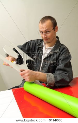 Adult Male Works In An Advertising Studio