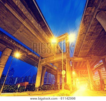 elevated express way Under view of the city overpass at night, HongKong Asia China
