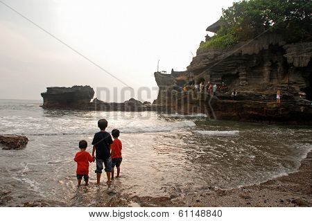 Tanah Lot Temple, Silhouette Of Three Boys