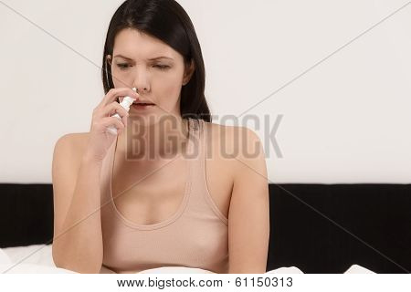 Woman Inhaling Nose Drops