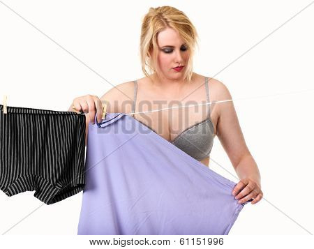 Sexy Blonde Woman Hanging Clothes
