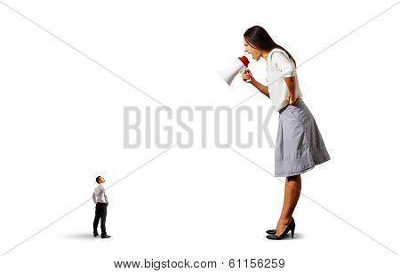 aggressive woman screaming at small man on the floor over white background