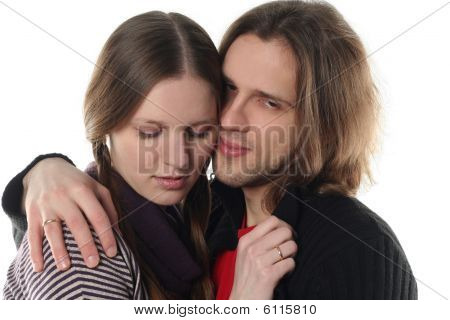 Portrait Of Young Couple In Studio Isolated On White Background