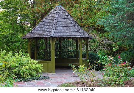 Wooden gazebo surrounded by colorful fall foliage in Toronto park