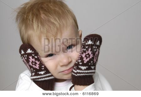 Small boy and mittens