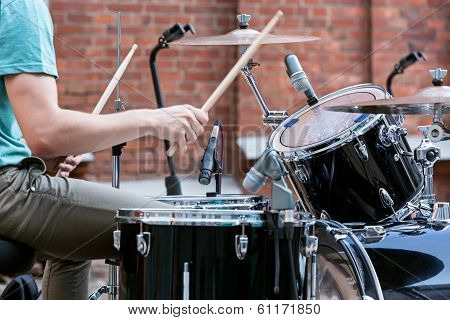 Drummer Man Playing On Drums