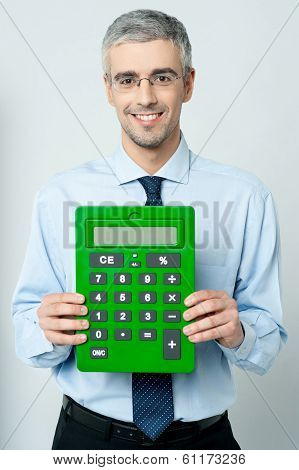 Corporate Man Showing Calculator