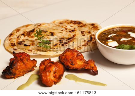 Paratha With Paneer Masala And Chicken Kebab.