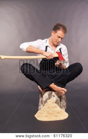 Country boy whittling with an axe