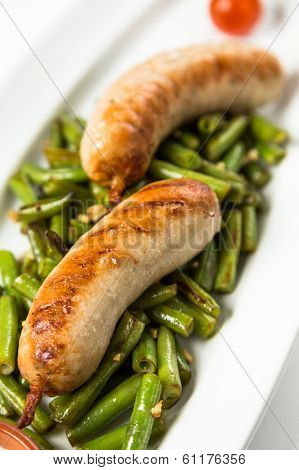 Roast Sausages On Garnish From Green Haricot