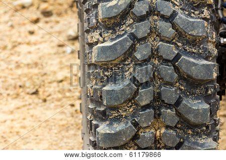 Tread Tire Coated In Mud