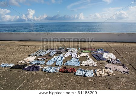 Drying Clothes On The Pavement At Seafront, Baracoa, Cuba